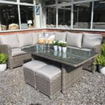 Outdoor dining corner sofa in dark grey weave and beige fleck coloured cushions.